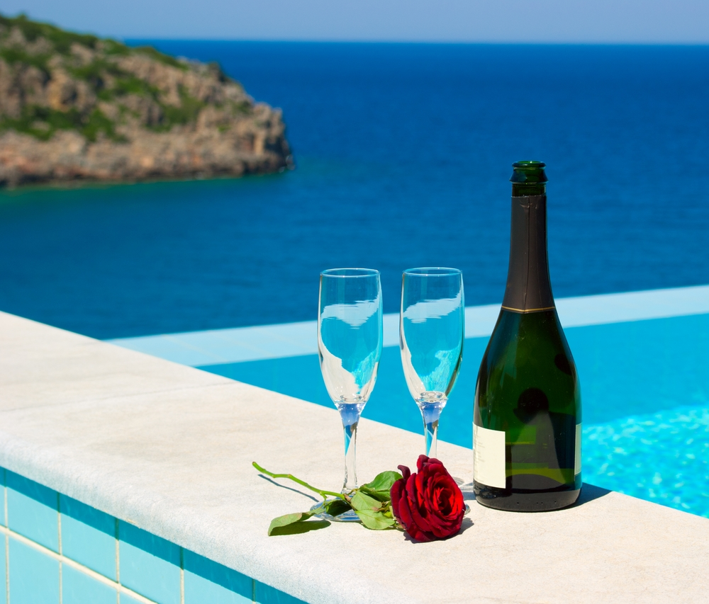 Indulge in a glass of bubbly to toast to your luxury travel in Greece and USA.