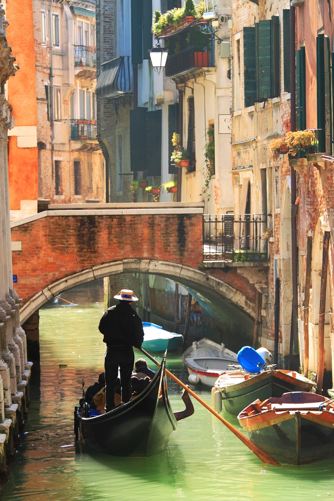 Head below the picturesque bridges of Venice onboard a gondola.